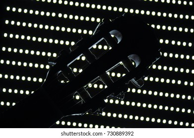 guitar head on the background of dot lights