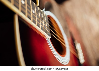 guitar leaning on a old wooden porch