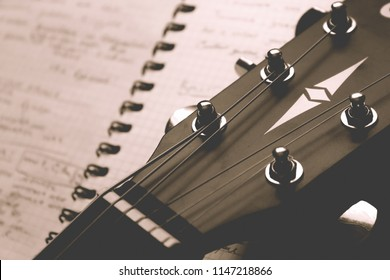 Сlassic guitar with and notebook, songwriting