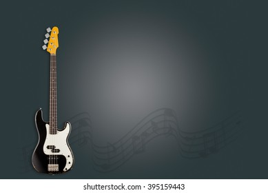 Guitar and notes on black background