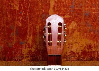guitar at the old wall.