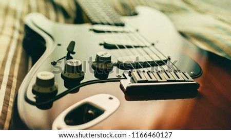 Guitar On Bed Stock Photo Edit Now 1166460127 Shutterstock