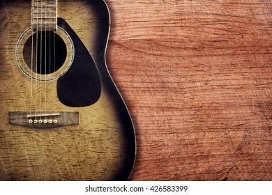 Guitar on wooden background vintage