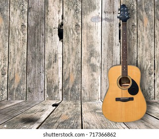 Guitar on wooden floor