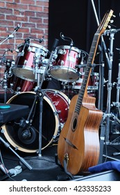 Guitar and other musical equipment on stage before concert
