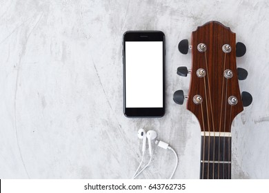 guitar and phone mobile white screen showing white screen top view