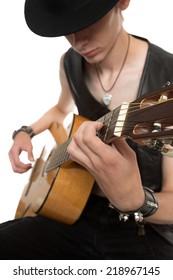 Guitar player in han playing his guitar.