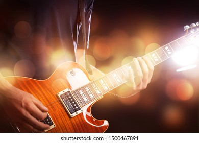 Guitar player on abstract bokeh background