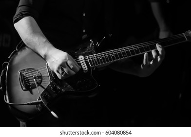 Guitar player on a festival concert of rock music in the hands of a guitarist musician