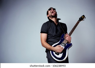 Guitar player. Rockstar playing on guitar.