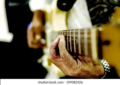 Guitar Playing with dramatic hands