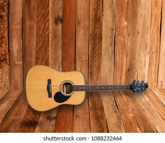 Guitar shadows on a wooden background.
