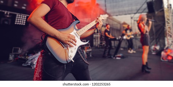 Guitar signer on stage closeup
