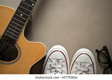 Guitar, sneakers, sunglasses , apparel accessories for vacation time