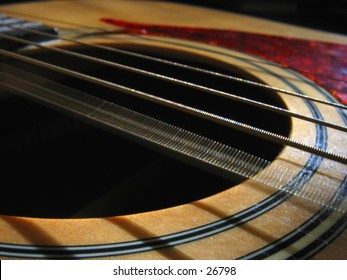 A guitar with it's string vibrating.
