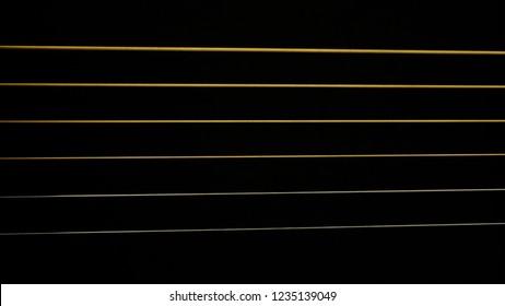 Guitar strings on black screen