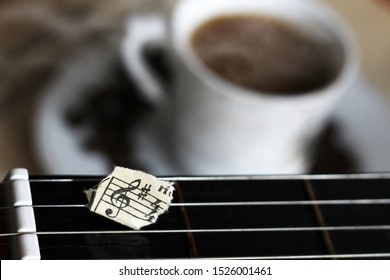 Guitar strings, torn paper notes and a Cup of coffee, music idea
