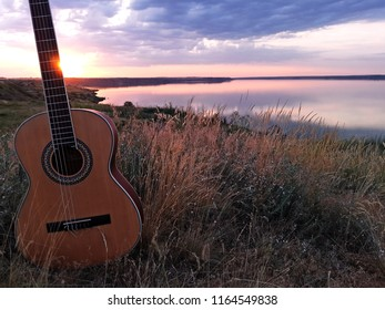 The guitar at sunset