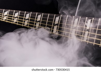 A guitar surrounded by smoke.