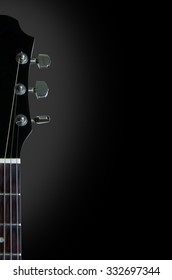 Guitar theme black background with a grey oval fade showing one half of the top of a black guitar with frets, strings, nut and tuning keys. Negative space available for text and other design elements.