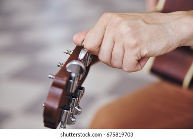 Guitar, tuning a musical instrument