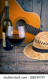 guitar and Wine on a wooden table summer background