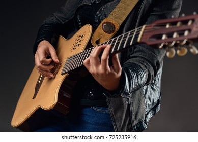 Guitar with woman's hands