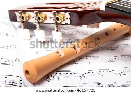 Guitar Wooden Flute On Sheet Music Stock Photo (Edit Now) 46157923