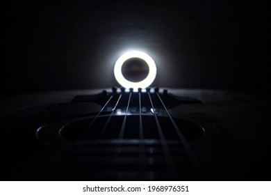 Guitar.Guitar chords with white light.Chords closeup.Music background.Guitar chords in the dark.Acoustic guitar closeup.Music in the dark