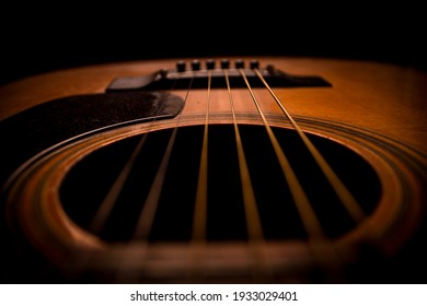 Guitar.Guitar's chords.Acoustic guitar.Music.Music background.Image of an acoustic guitar in the dark.Playing music with some friends in the dark.Classical music.Guitar closeup