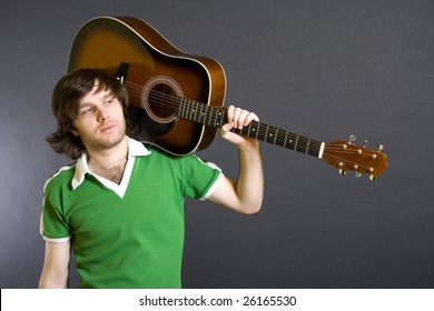 guitarist with an acoustic guitar on shoulder