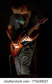 guitarist at the concert on dark background