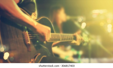 Guitarist on stage for background, soft and blur concept, Vintage color tone style