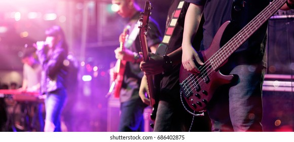 Guitarist on stage for background, soft focus and blur concept