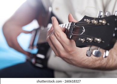 Guitarist on stage in the stage light