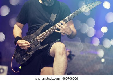 Guitarist on stage, night entertainment, music festival