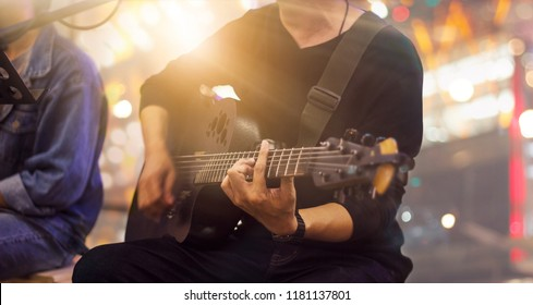 Guitarist on stage and singer at a concert for background, soft and blur concept