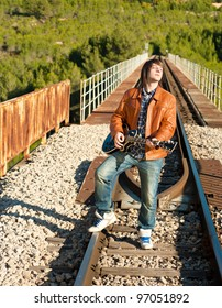 Guitarist performing on a railway bridge