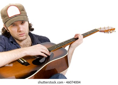 guitarist playing an acoustic guitar seated over white
