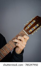 Guitarist playing C Major Chord on classical acoustic guitar with nylon strings