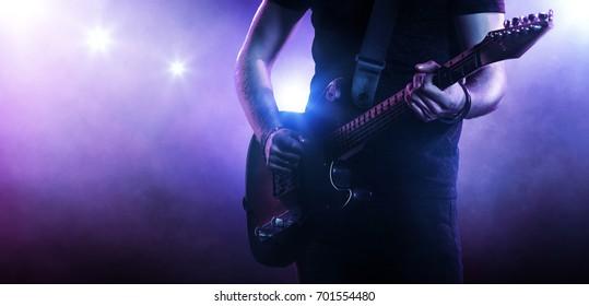 Guitarist playing a guitar