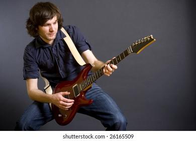 guitarist playing his electric guitar