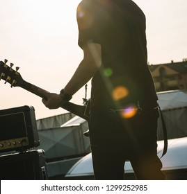 Guitarist playing outdoors