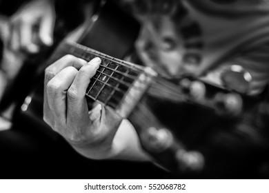 Guitarist press finger on the fretboard