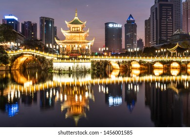 Guiyang, China - February 9 2019: Twilight over the famous Jiaxu tower in the heart of Guiyang downtown district in Guizhou province in China.