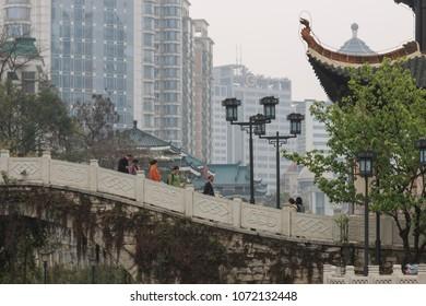 Guiyang, China - March 25, 2018: Cityscape of Guiyang at noon, Jiaxiu Pavilion on the Nanming River. Located in Guiyang City, Guizhou Province, China.