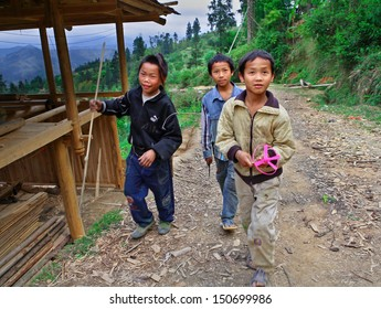 GUIZHOU, CHINA - APRIL 10: Unidentified Chinese teenagers aged 12 years and stroll around the neighborhood of Basha village, April 10, 2010. Basha Village, Congjiang County.