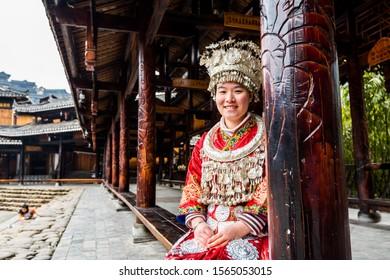 Guizhou, China, Jan 21, 2019, Chines Miao woman wearing traditional clothes in Xijiang Qianhu Miao Village (One Thousand Household Miao Village) , in Guizhou province of China.