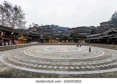 Guizhou, China, Jan 21, 2019, Traditional wooden building and open opera house of Xijiang Qianhu Miao Village (The One Thousand Household Miao Village) , in southeastern Guizhou province of China.