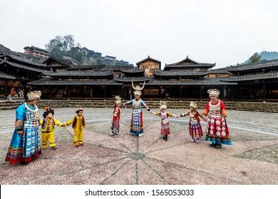 Guizhou, China, Jan 21, 2019, The Chinese miao women and kids wearing traditional clothes and dancing in open opera house of Xijiang Qianhu Miao Village (One Thousand Household Miao Village) ,